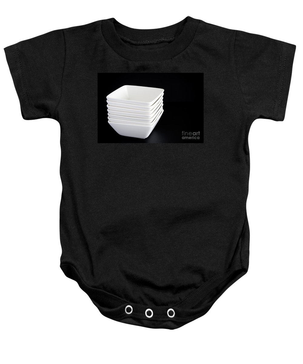 Bowl Baby Onesie featuring the photograph White Bowls On Black by Tim Hester