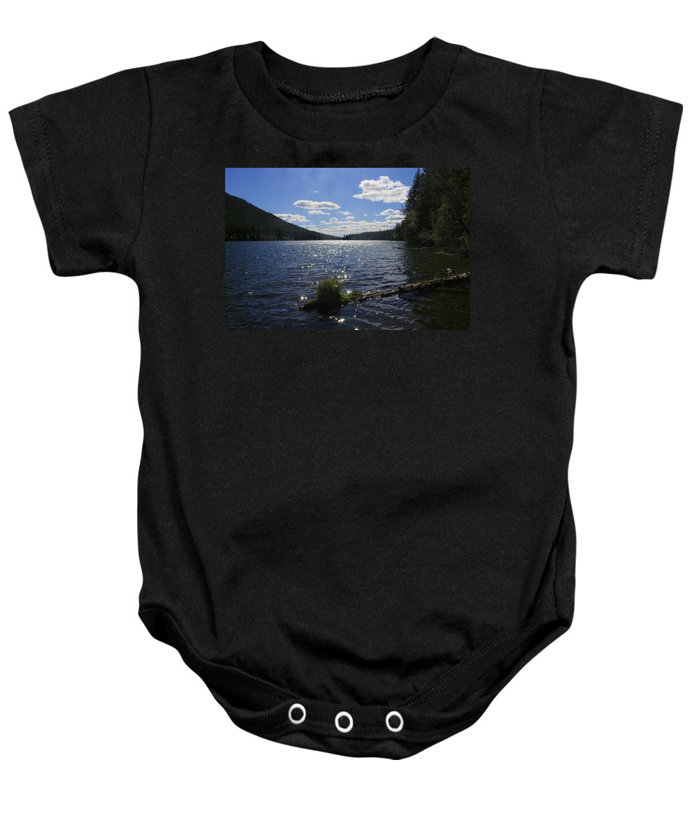 Baby Onesie featuring the photograph Why They Call It Jewel by John Greaves