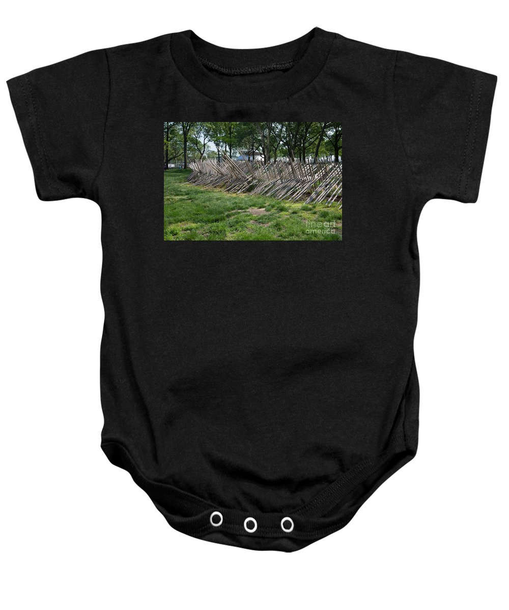 Downtown Baby Onesie featuring the digital art Wooden Spiked Fence by Carol Ailles