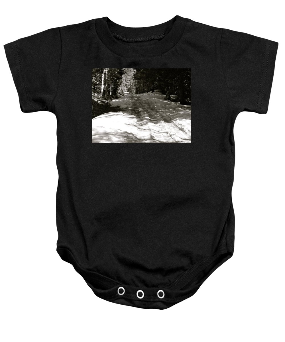 Snow Baby Onesie featuring the photograph Snow In April by Linda Hutchins