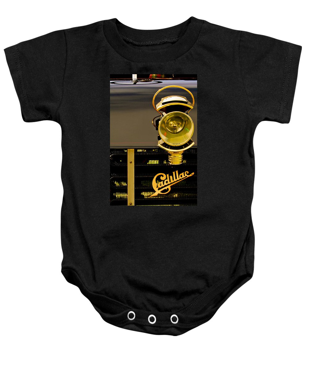 1903 Cadillac Model A Wilson Rear Entrance Tonneau Baby Onesie featuring the photograph 1903 Cadillac Model A Wilson Rear Entrance Tonneau Lamp And Grille Emblem by Jill Reger