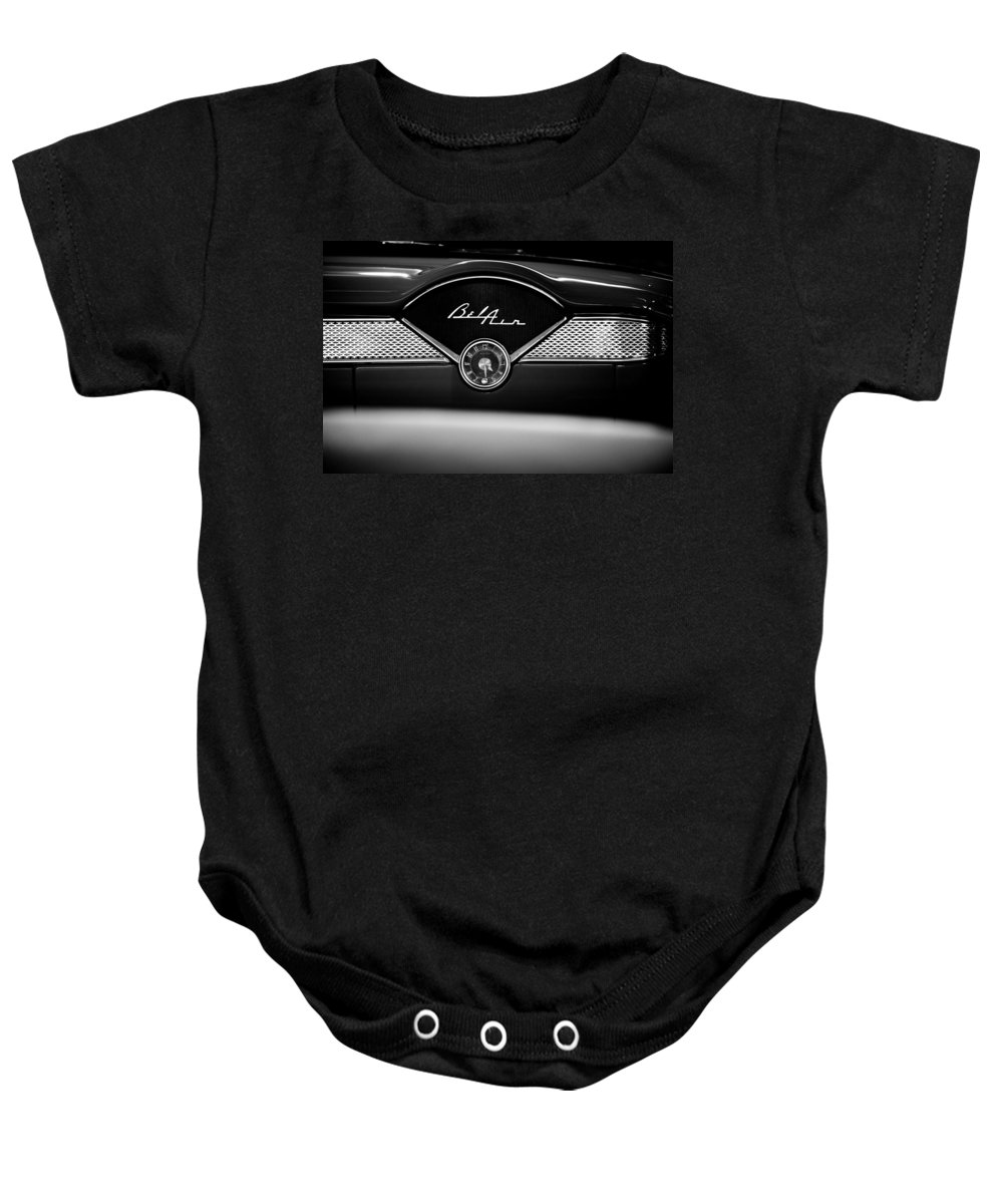 1955 Bel Air Baby Onesie featuring the photograph 1955 Chevy Bel Air Glow Compartment In Black And White by Sebastian Musial
