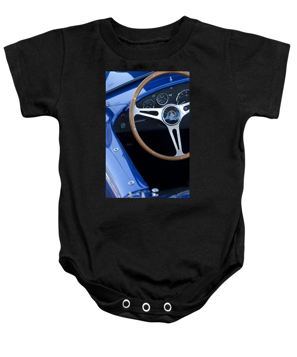 1965 Cobra Sc Baby Onesie featuring the photograph 1965 Cobra Sc Steering Wheel 2 by Jill Reger