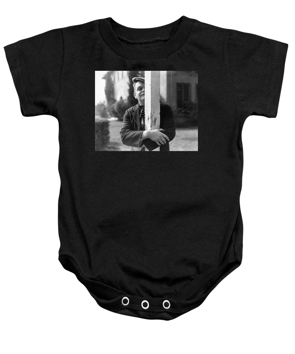 -man Single- Baby Onesie featuring the photograph Silent Still: Single Man by Granger