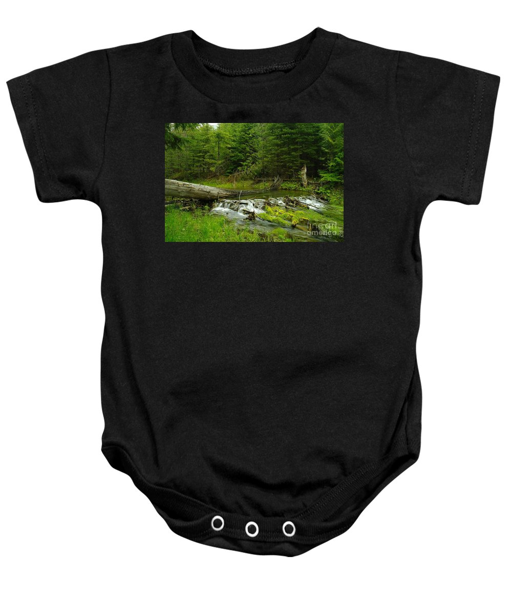 Water Baby Onesie featuring the photograph A Beaver Dam Spilling Over by Jeff Swan