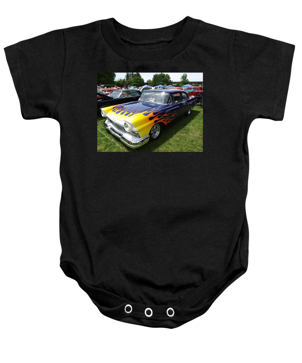Blue Baby Onesie featuring the photograph A Flaming Ride by Teri Schuster