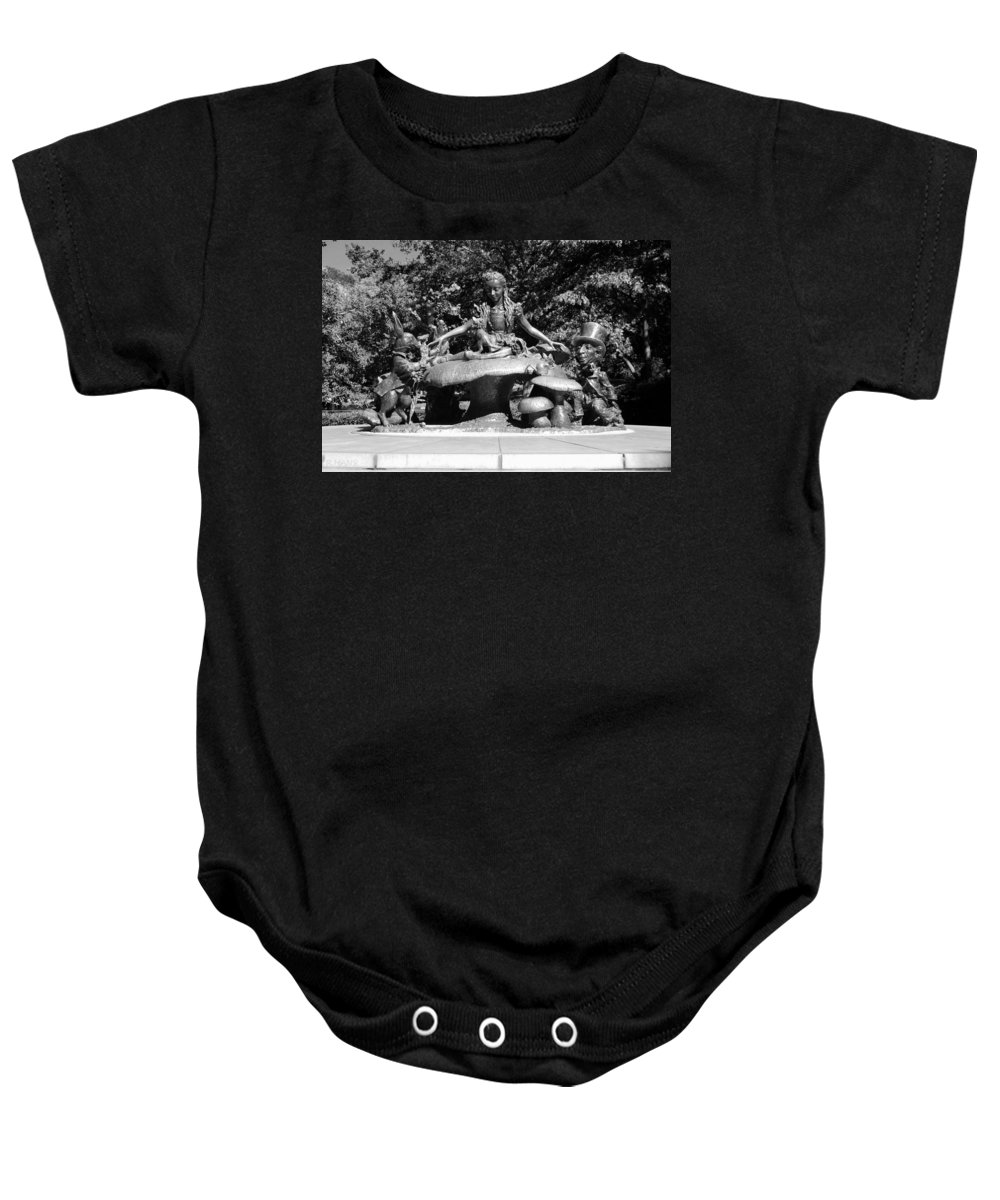 Central Park Baby Onesie featuring the photograph ALICE IN WONDERLAND in CENTRAL PARK in BLACK AND WHITE by Rob Hans