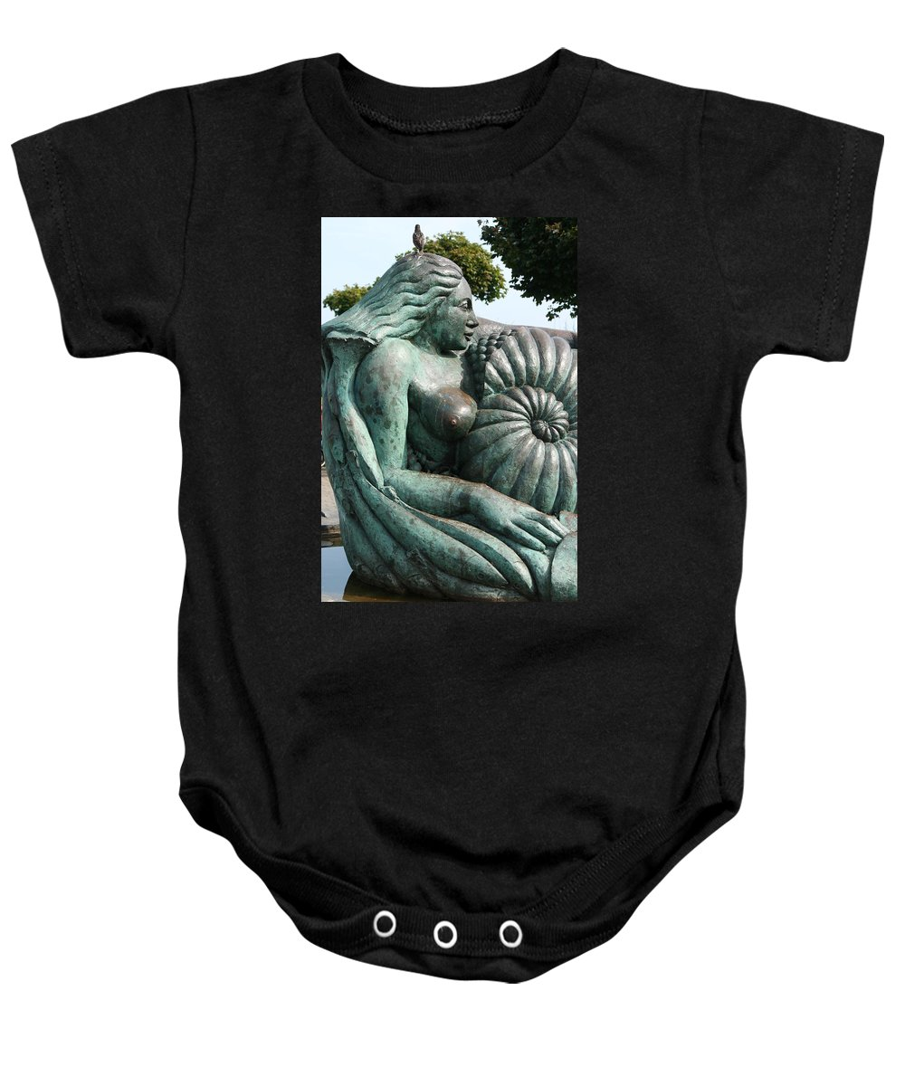 Statue Baby Onesie featuring the photograph Ammonite Statue by Carol Ann Thomas