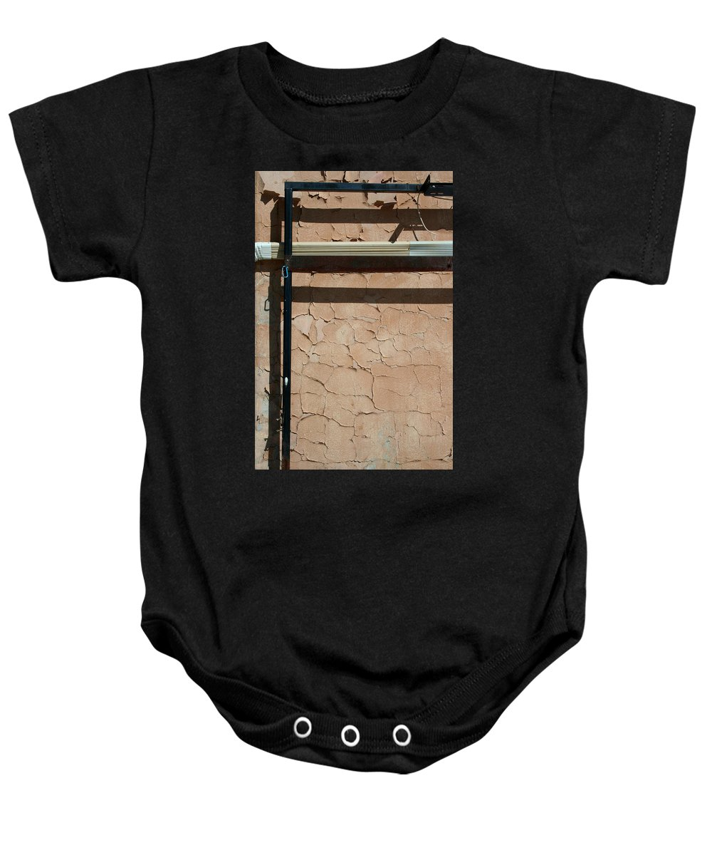 Wall Baby Onesie featuring the photograph An Abstracted Wall by Ric Bascobert
