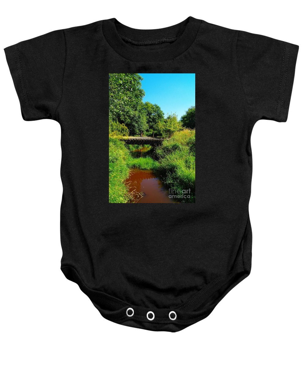 Bridges Baby Onesie featuring the photograph An Old Rail Road Bridge by Jeff Swan