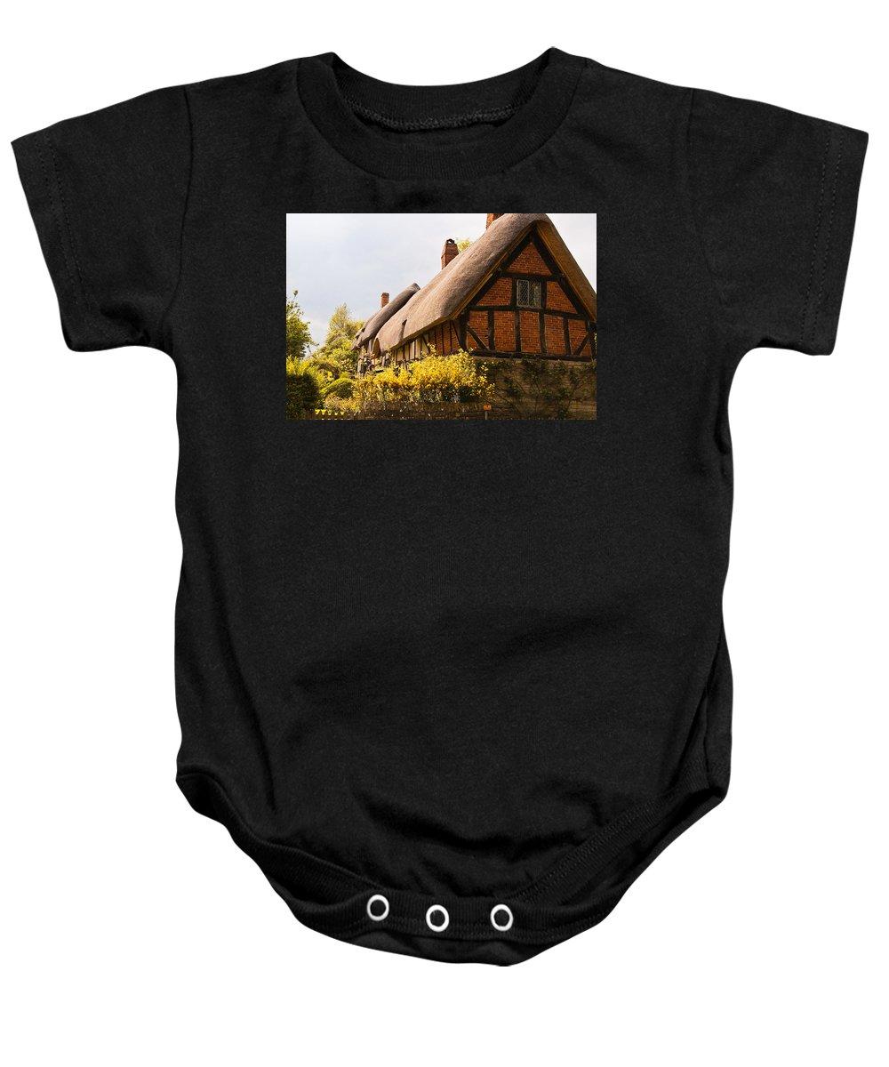 Stratford On Avon Baby Onesie featuring the photograph Ann Hathaway Home by Jon Berghoff
