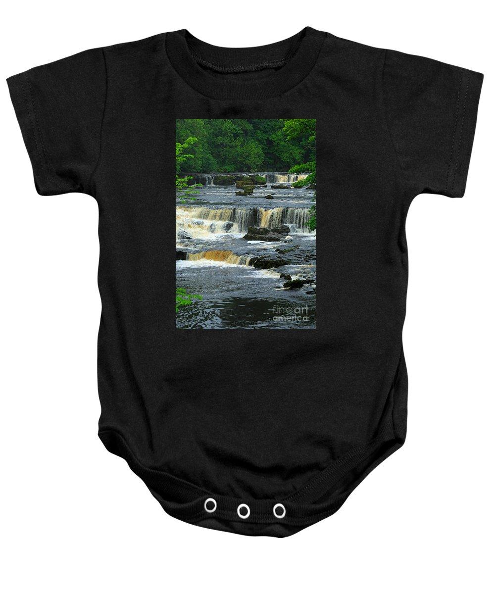 Aysgarth Falls Baby Onesie featuring the photograph Aysgarth Falls Wensleydale by Louise Heusinkveld