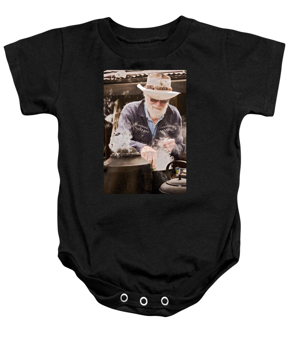 Making Billy Tea Baby Onesie featuring the photograph Bearded Miner Making Billy Tea by Sally Weigand