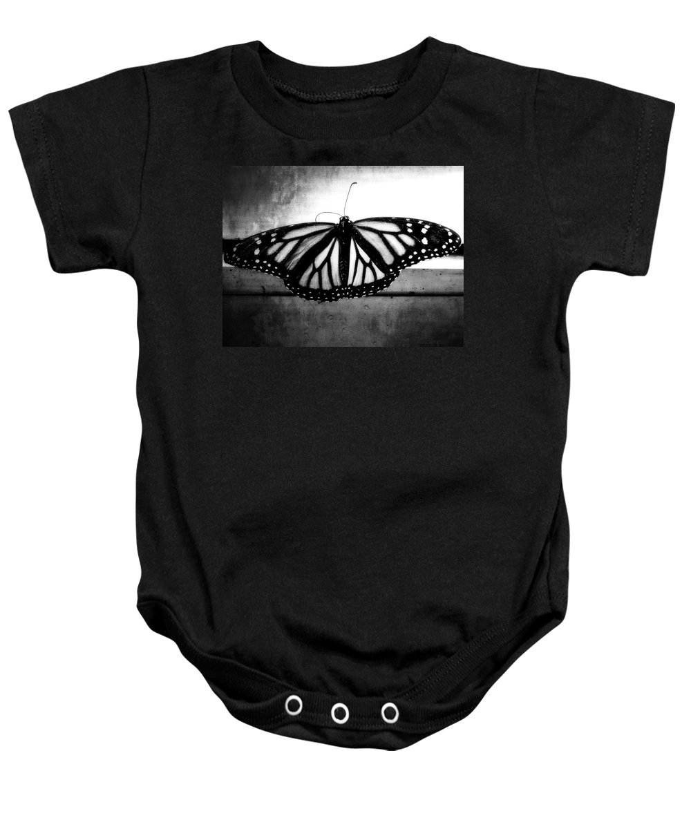 Black And White Baby Onesie featuring the photograph Black Butterfly by Julia Wilcox