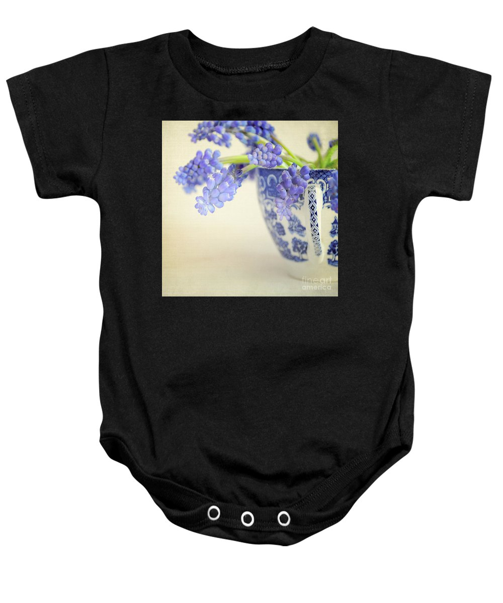 Muscari Baby Onesie featuring the photograph Blue Muscari Flowers In Blue And White China Cup by Lyn Randle