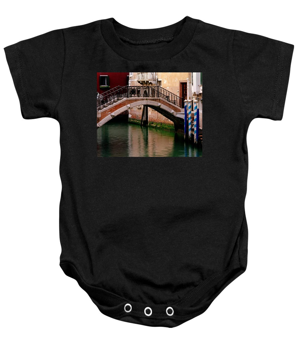 Venice Baby Onesie featuring the photograph Bridge And Striped Poles Over A Canal In Venice by Greg Matchick