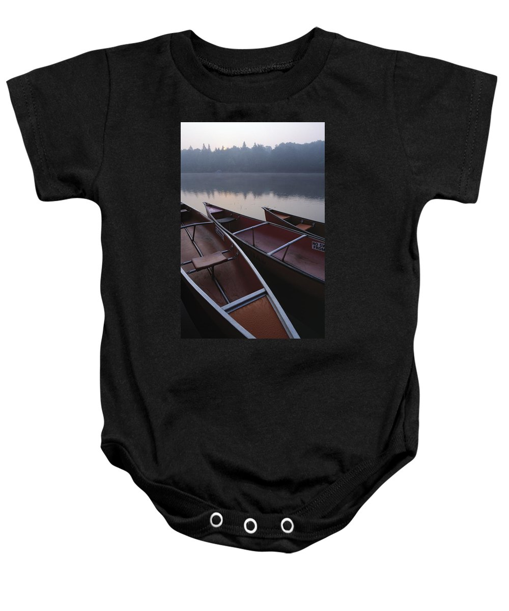 Canoe Baby Onesie featuring the photograph Canoes On Still Water by Natural Selection John Reddy