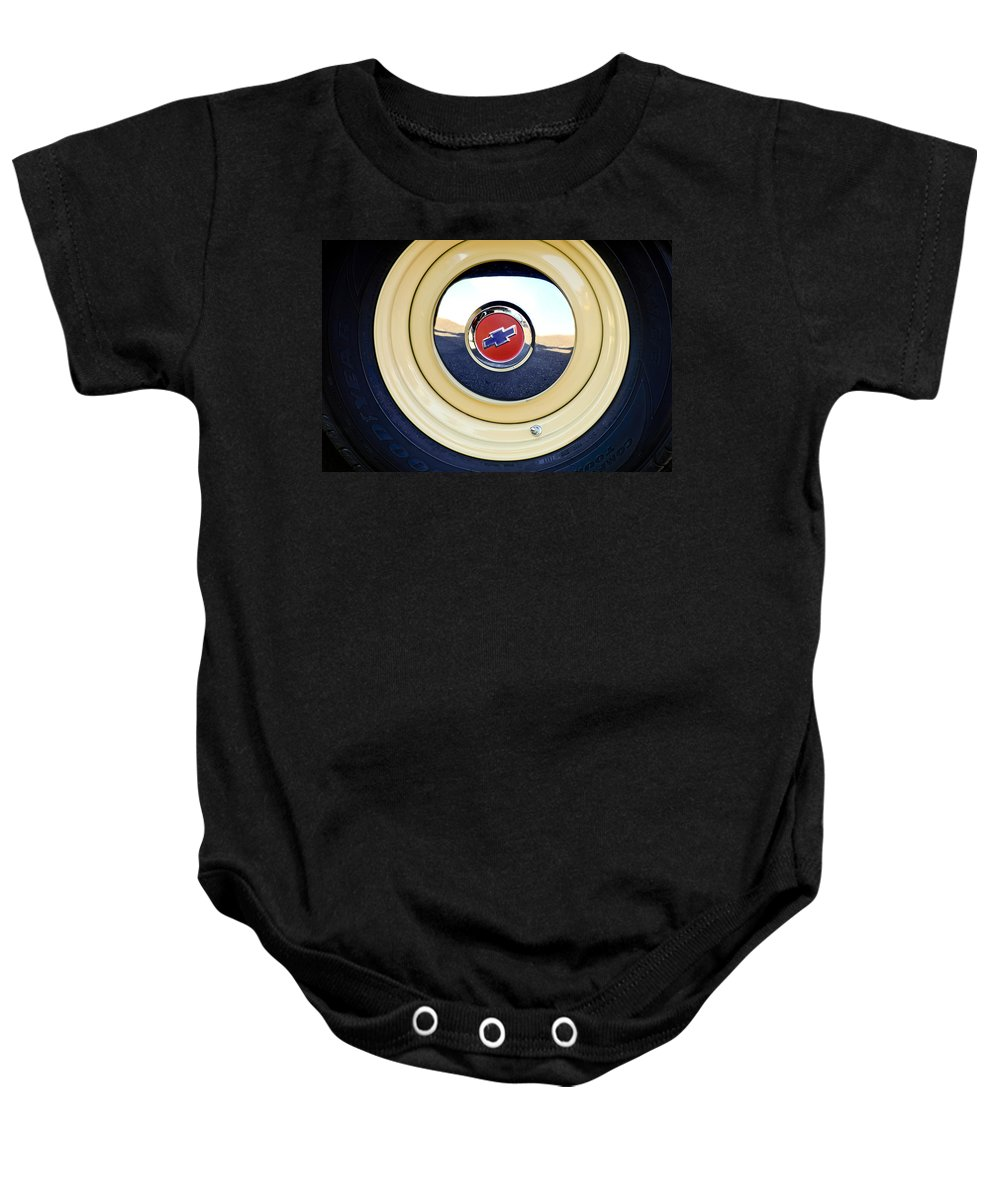 Chevrolet Baby Onesie featuring the photograph Chevrolet Wheel Emblem by Jill Reger