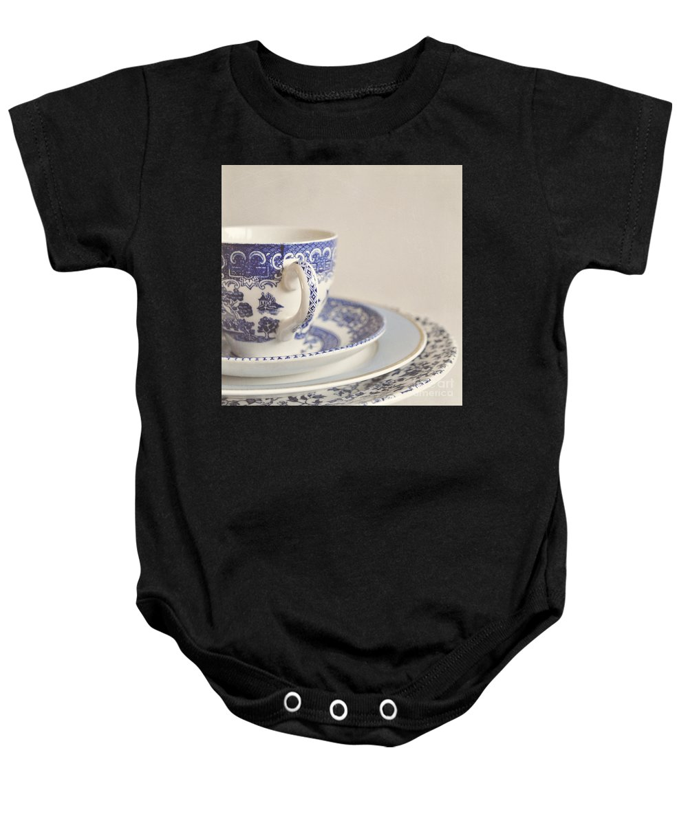 Cup Baby Onesie featuring the photograph China Cup And Plates by Lyn Randle