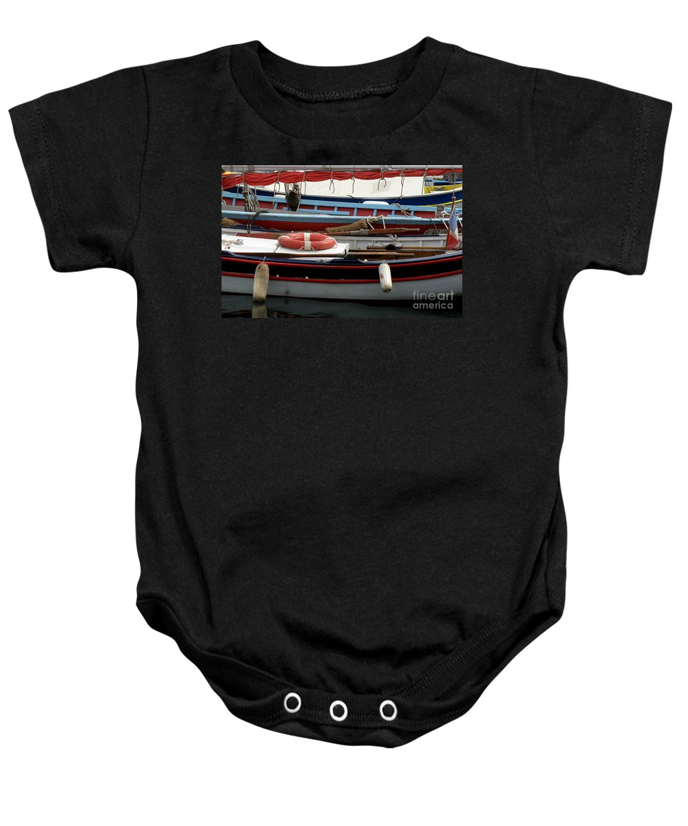 Boats Baby Onesie featuring the photograph Colorful Wooden Boats by Lainie Wrightson