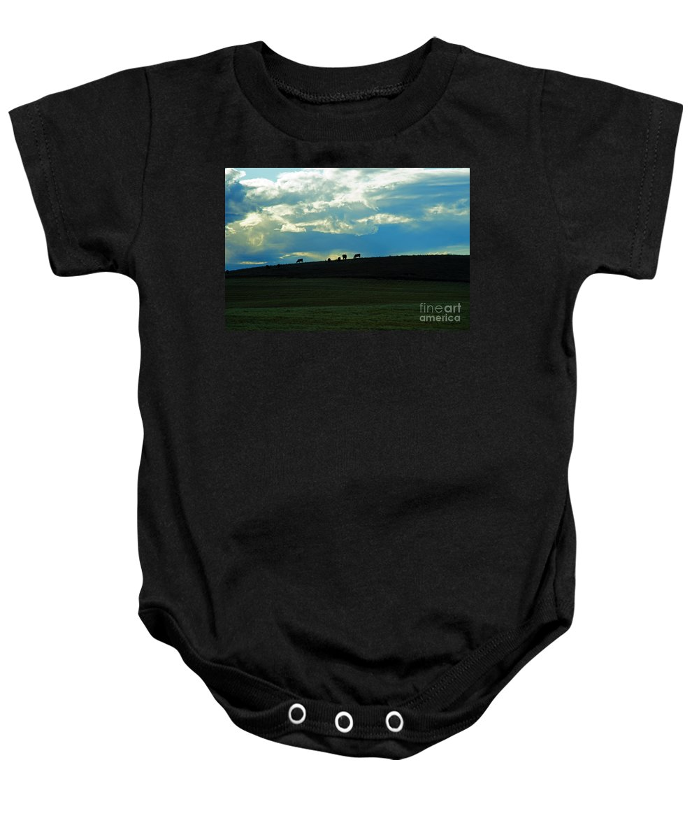 Cattle Baby Onesie featuring the photograph Cows On The Hill by Randy Harris