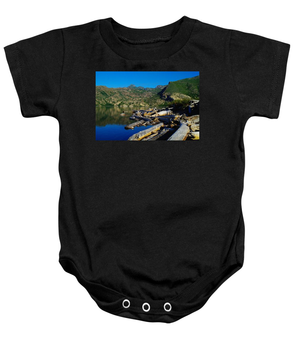 Driftwood Baby Onesie featuring the photograph Driftwood by Jeff Swan
