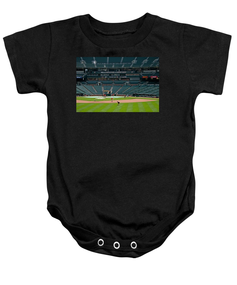 oriole Park Baby Onesie featuring the photograph Early Warm Up's From Left Center by Paul Mangold