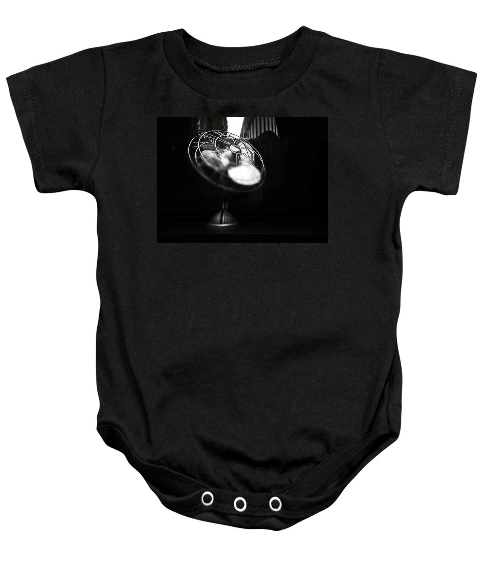 Fan Baby Onesie featuring the photograph Ebony Wind by Charles Stuart