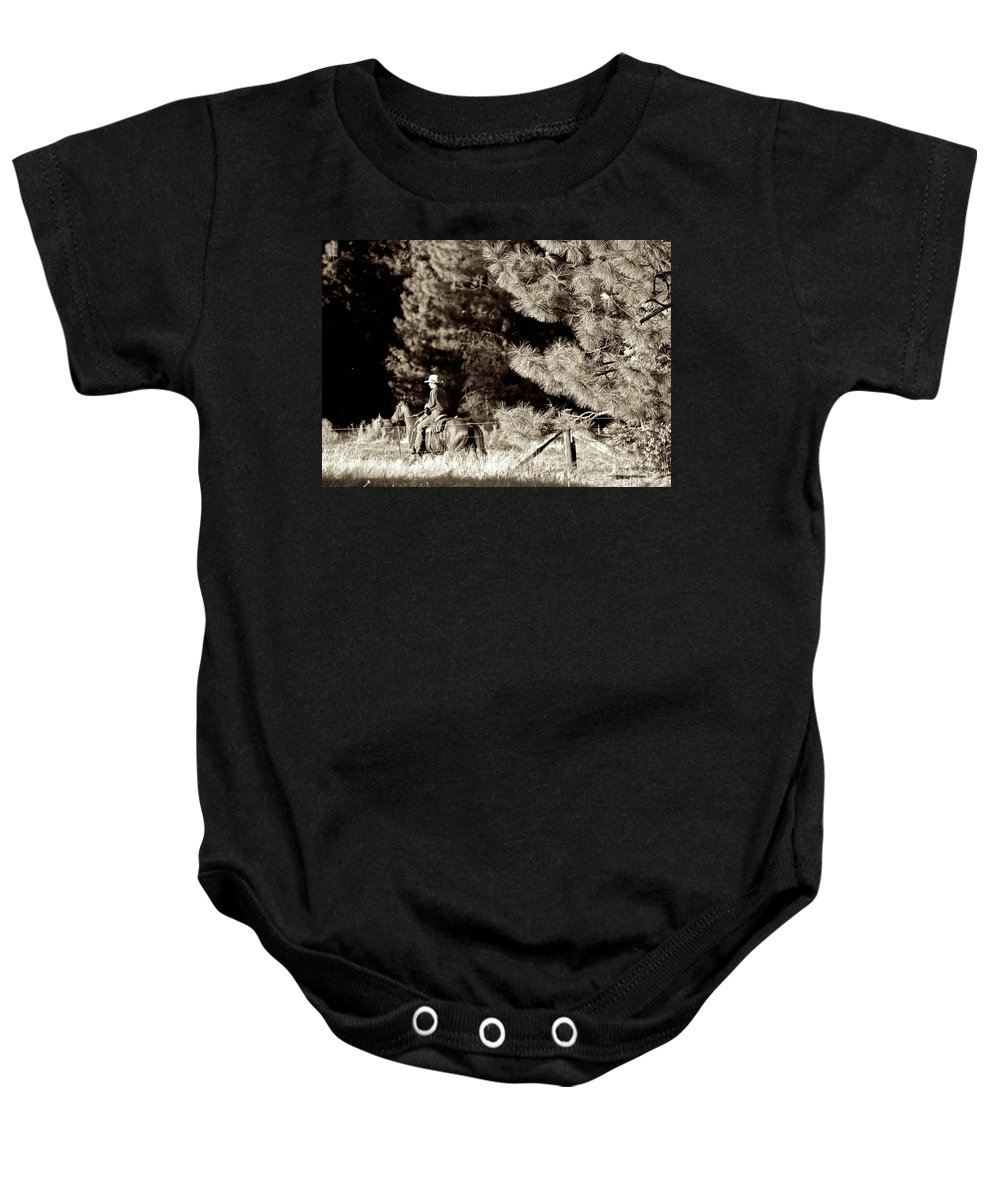 Cowboy Baby Onesie featuring the photograph Fence Checkin' by Eric Tressler
