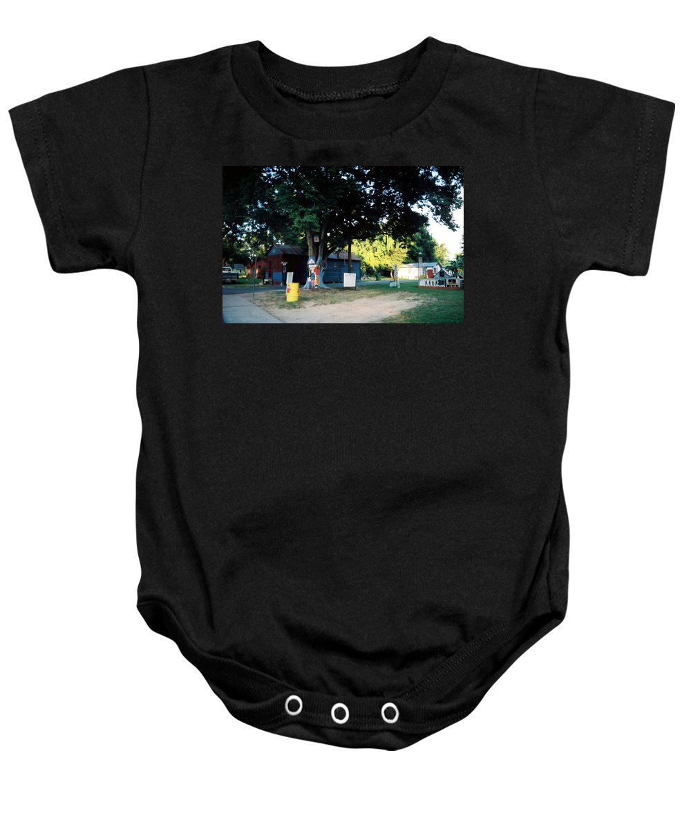 Louisiana Baby Onesie featuring the photograph Folk Art Yard And Tree by Doug Duffey