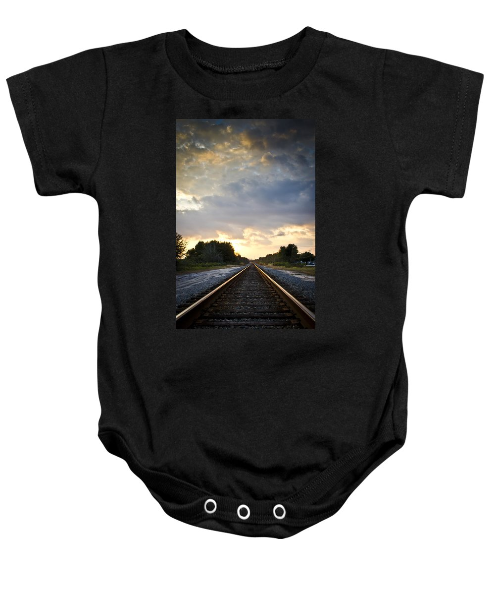 Train Baby Onesie featuring the photograph Follow The Tracks by Carolyn Marshall