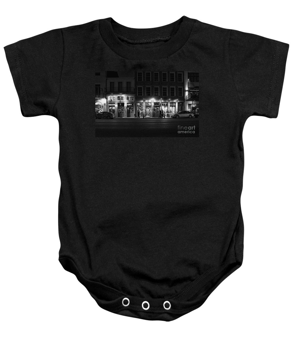 Night Baby Onesie featuring the photograph French Quarter Shopping At Night - Black And White by Kathleen K Parker
