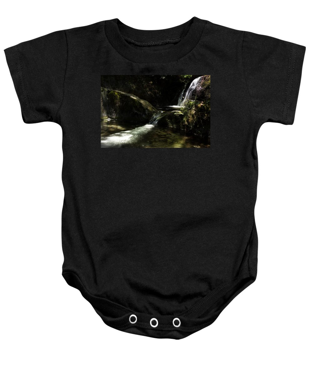 Water Baby Onesie featuring the photograph From The Bowels Of The Earth by Edgar Laureano
