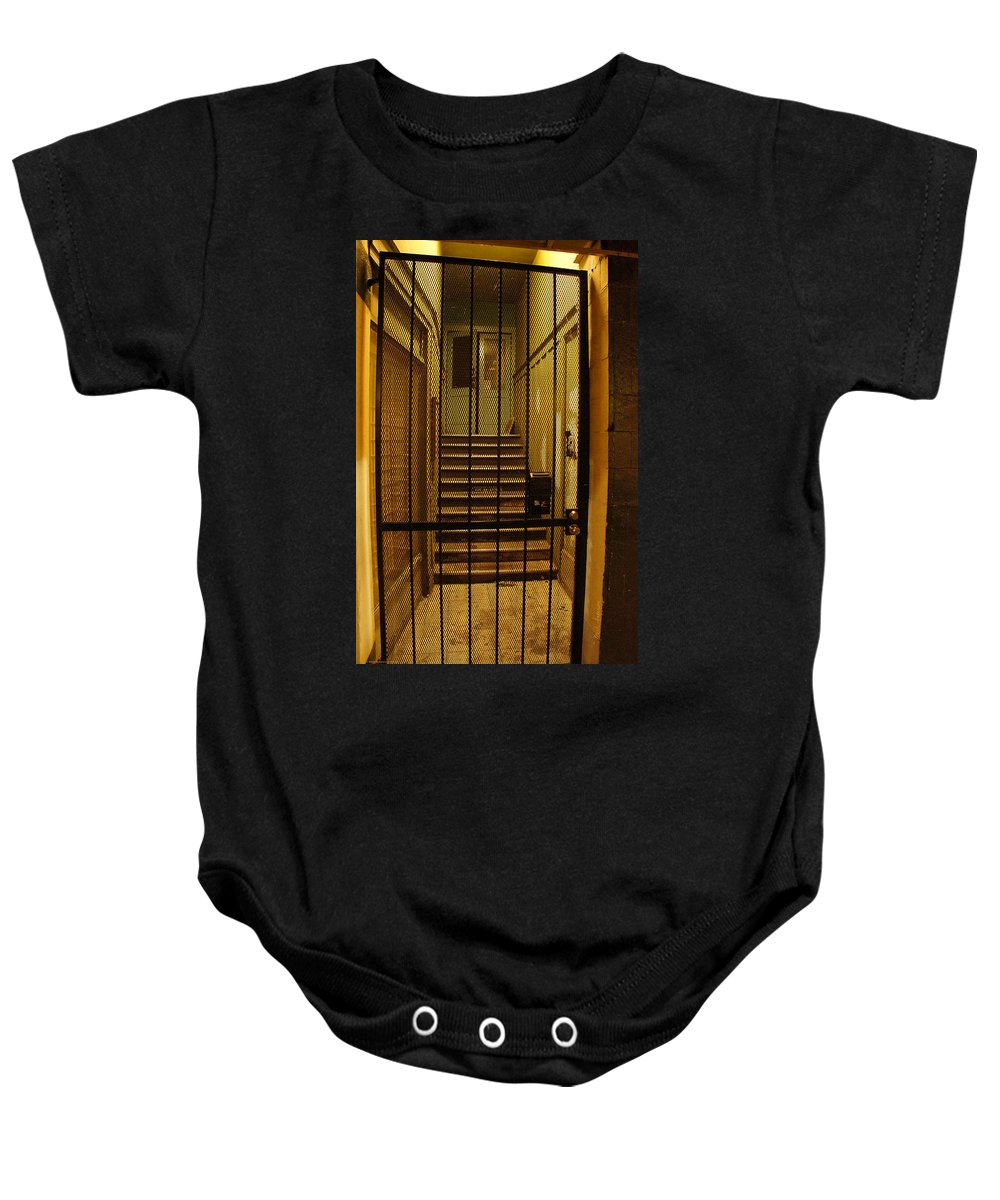 Gated Baby Onesie featuring the photograph Gated Stairwell At Night by Mick Anderson