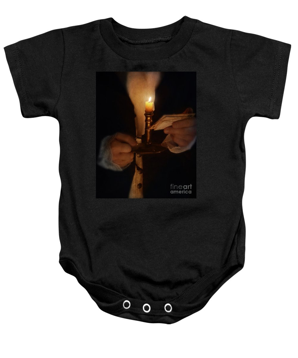 Gentleman Baby Onesie featuring the photograph Gentleman In Vintage Clothing With Candlestick And Letters by Jill Battaglia