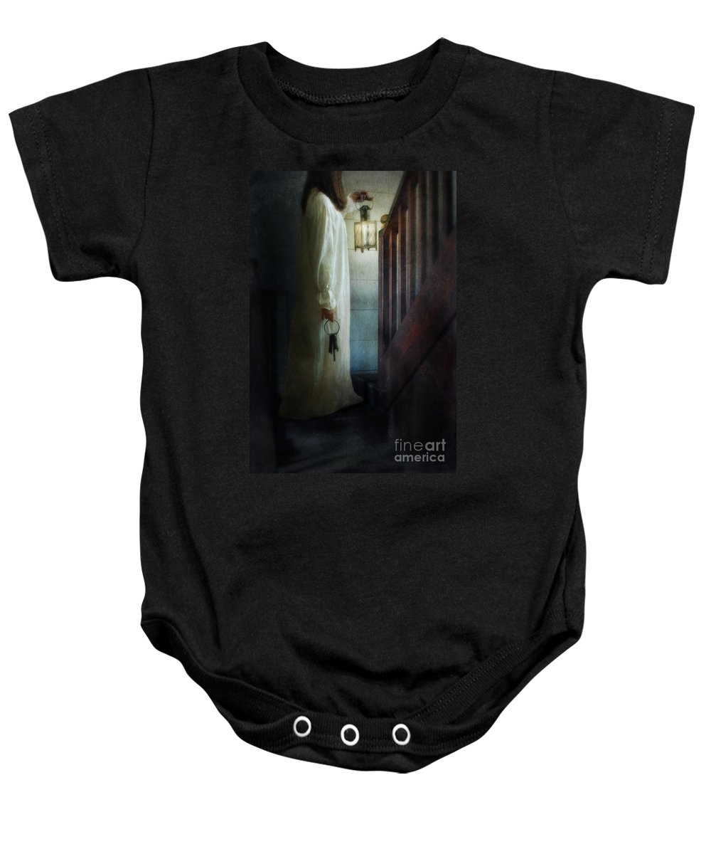 Woman Baby Onesie featuring the photograph Girl On Stairs With Lantern And Keys by Jill Battaglia