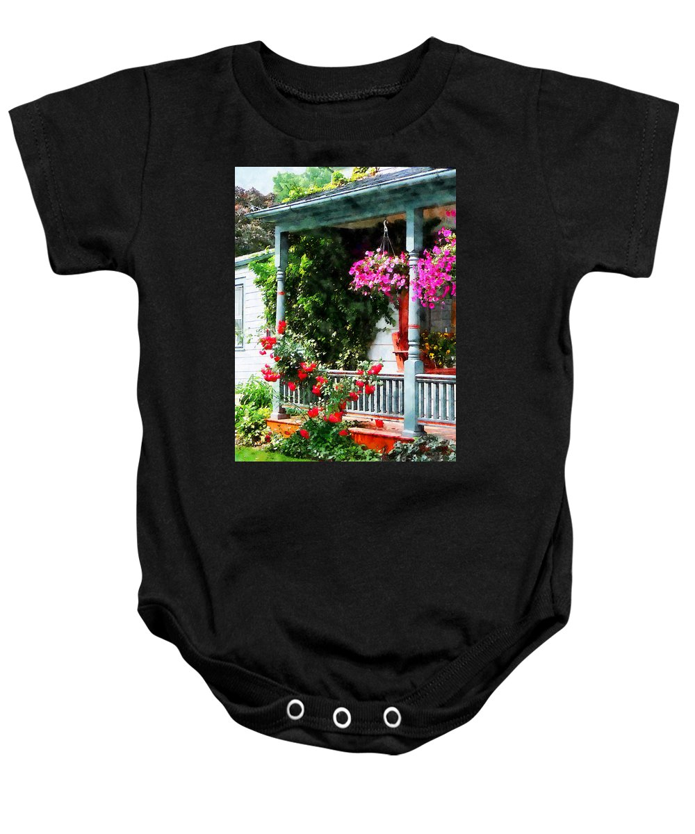 Hanging Baskets Baby Onesie featuring the photograph Hanging Baskets And Climbing Roses by Susan Savad