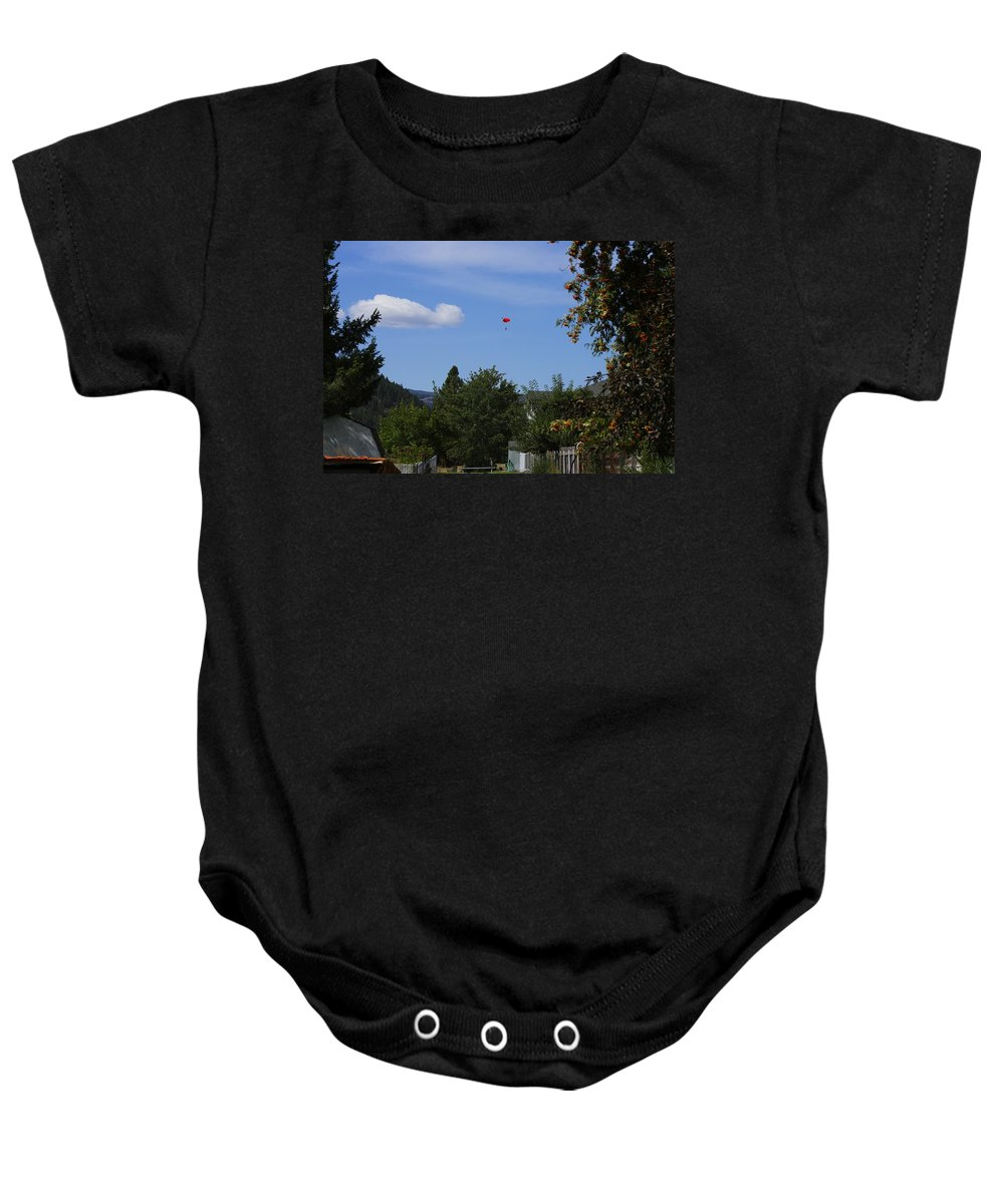 Baby Onesie featuring the photograph Hanging Out Over Midway by John Greaves