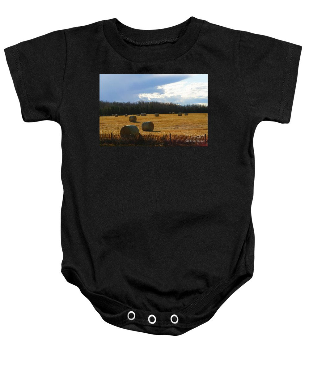 Hay Bails Baby Onesie featuring the photograph Hay Bails by Randy Harris