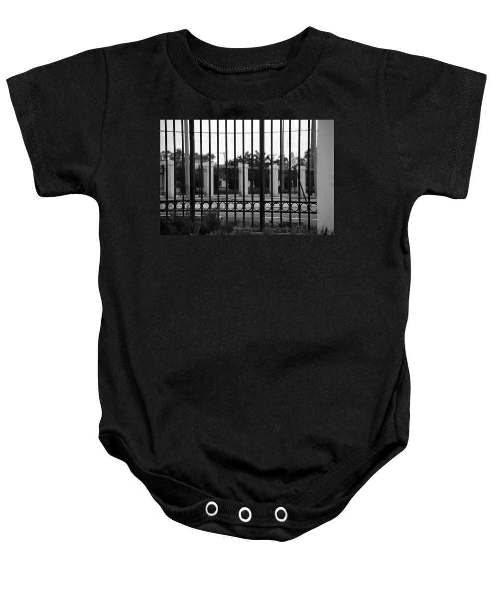 Black And White Baby Onesie featuring the photograph Iron And Pillars by Rob Hans