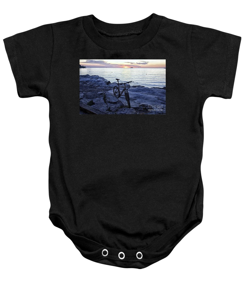 Bike Baby Onesie featuring the photograph Journey's End by Madeline Ellis