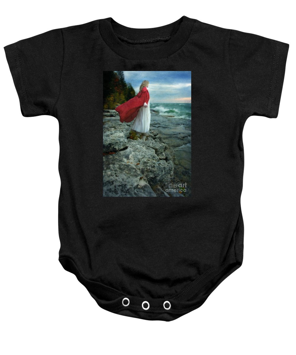Walking Baby Onesie featuring the photograph Lady In Vintage Clothing By The Sea by Jill Battaglia