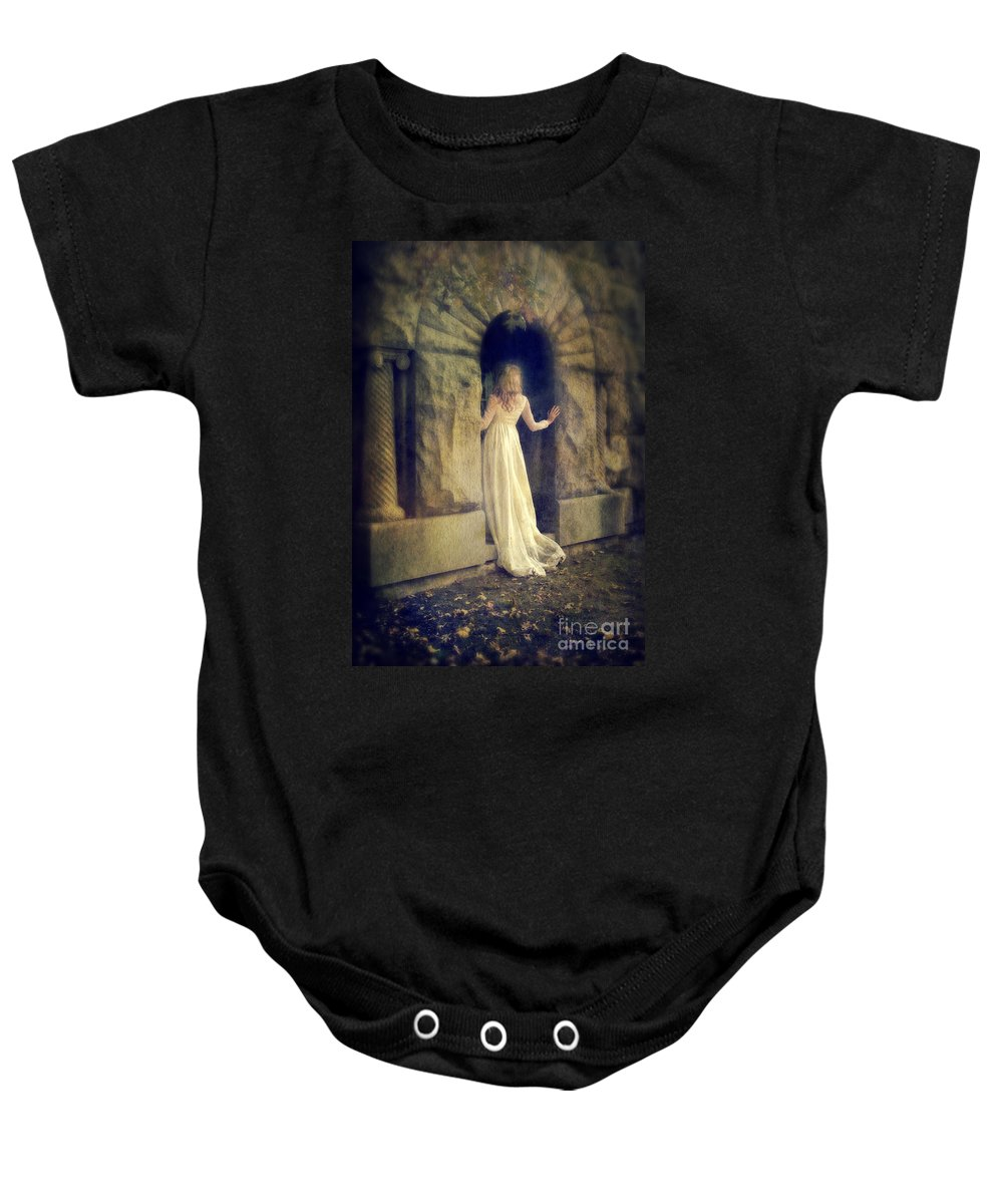 Lady In Doorway Baby Onesie featuring the photograph Lady In White Gown In Doorway by Jill Battaglia