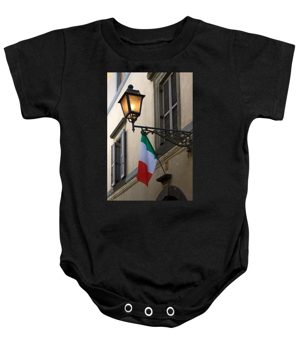 Lighted Anique Wall Light Baby Onesie featuring the photograph Lamp And Flag by Sally Weigand