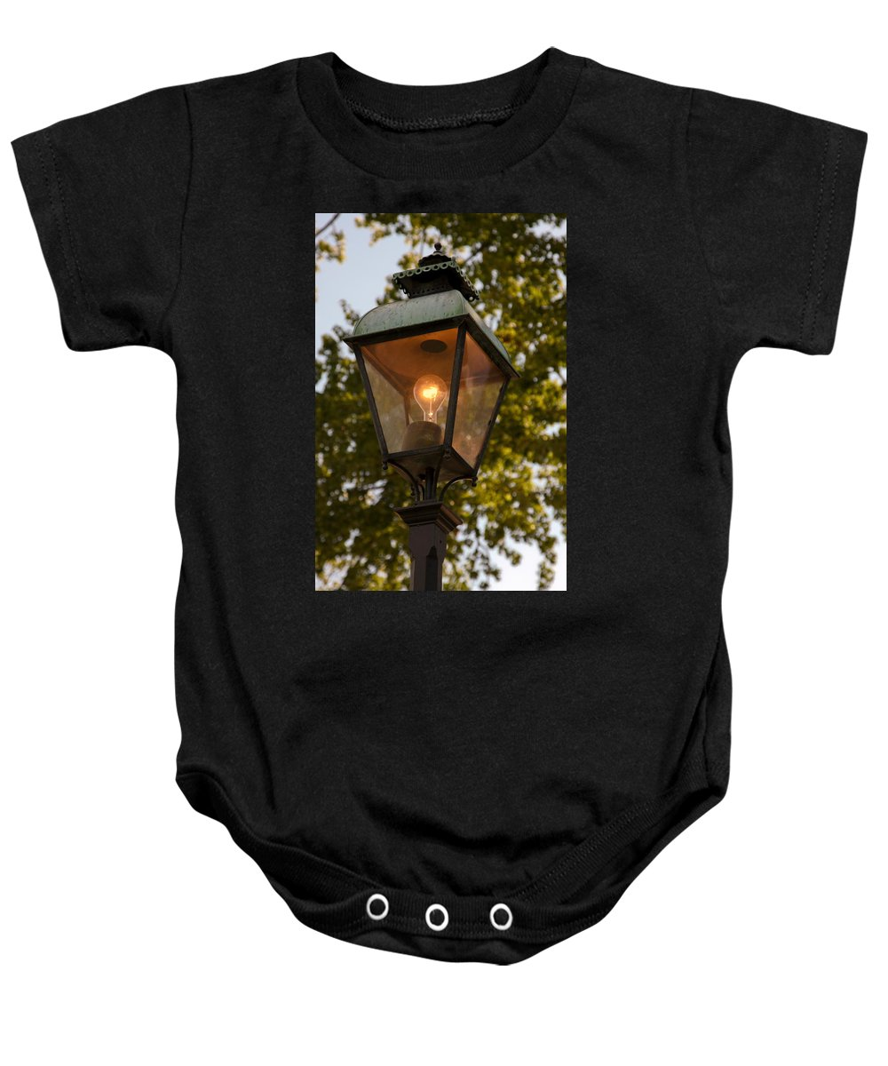 Lighted Street Lamppost Baby Onesie featuring the photograph Lighted Street Lamppost by Sally Weigand