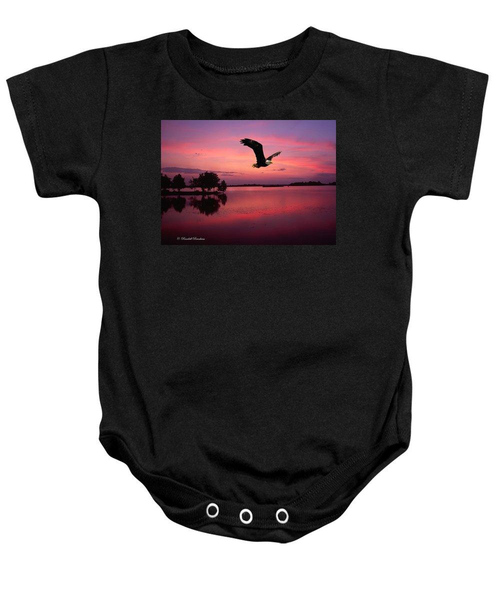 Eagle At Mauve Sundown Baby Onesie featuring the photograph Mauve Sundown Eagle by Randall Branham