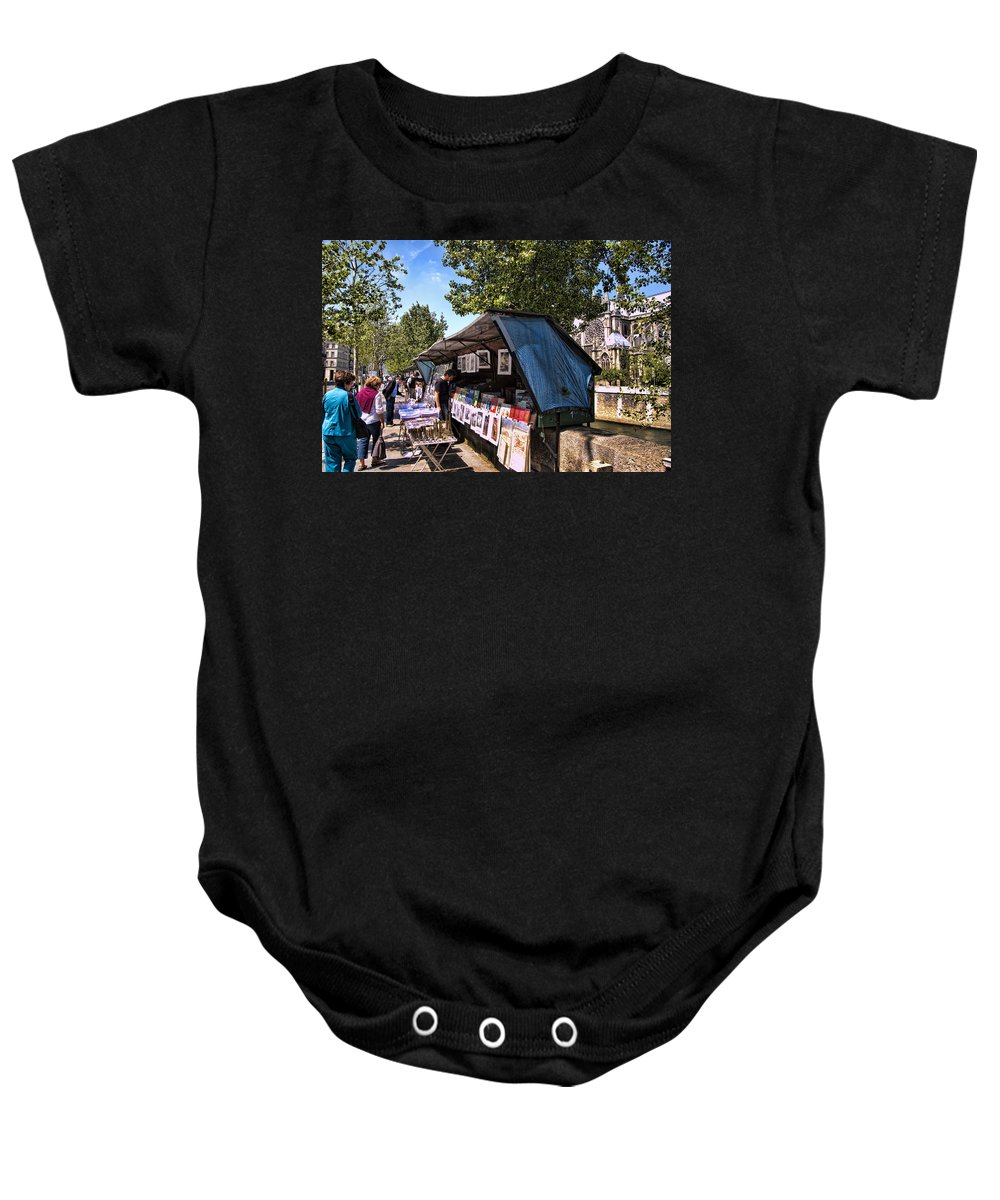 Notre Dame Cathedral Baby Onesie featuring the photograph Newstand Along The Seine by Jon Berghoff