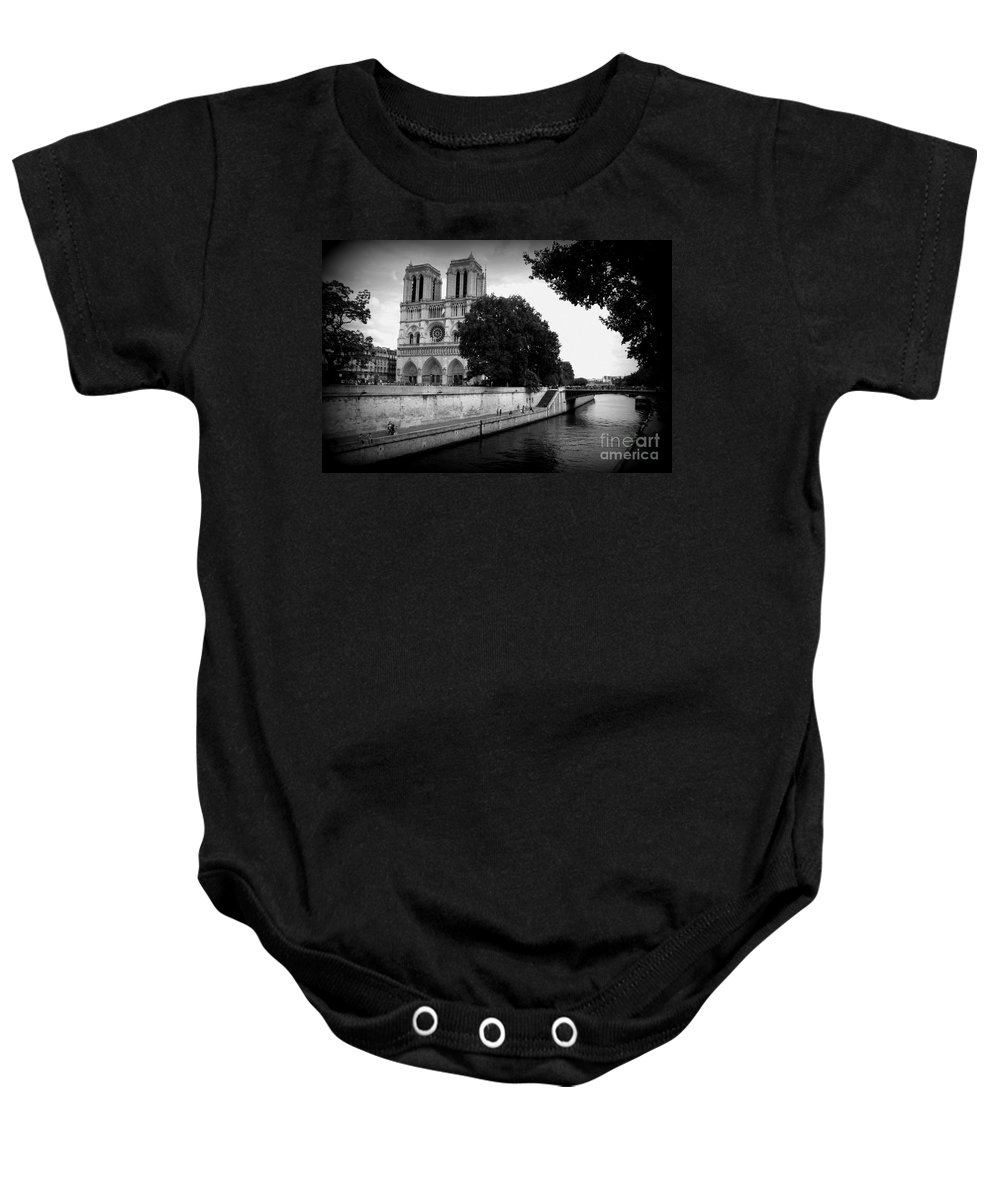Notre Dame Baby Onesie featuring the photograph Notre Dame Along The Seine by Carol Groenen
