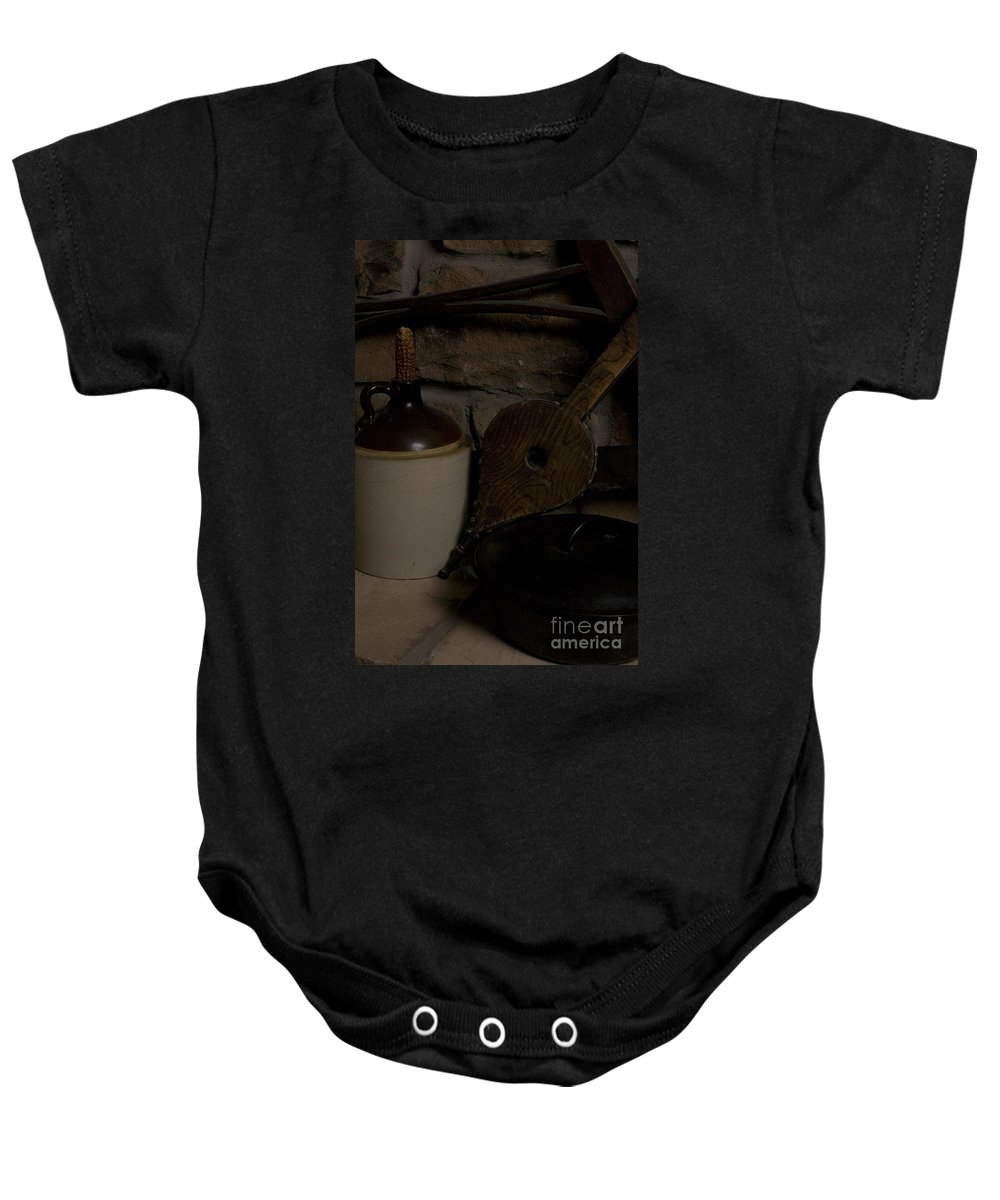Antique Baby Onesie featuring the photograph Old Items On A Stone Hearth 1 by Alan Look