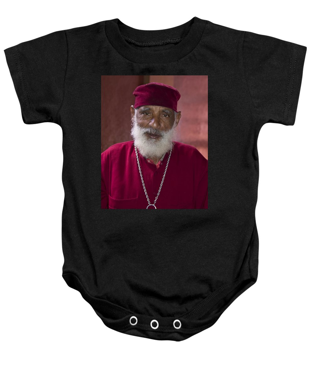 Africa Baby Onesie featuring the painting Orthodox Priest Of Addis Ababa by Robert SORENSEN